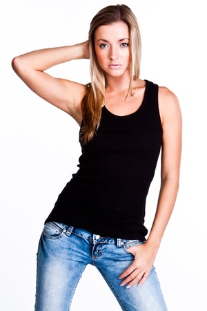 young woman: Young, beautiful and happy woman in a black shirt and blue jeans