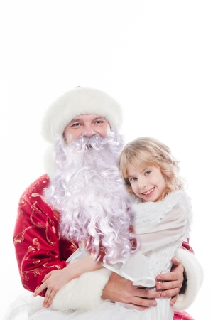 Santa Claus gives gifts to the pretty little girl Stock Photo - 16637946