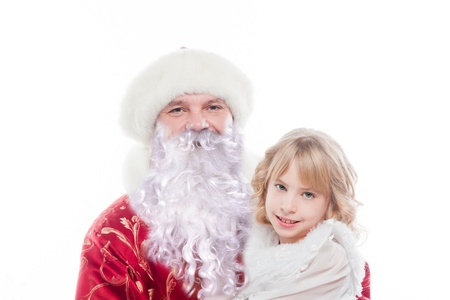 Santa Claus gives gifts to the pretty little girl Stock Photo - 16637929