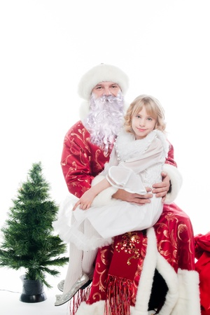 Santa Claus gives gifts to the pretty little girl Stock Photo - 16637942