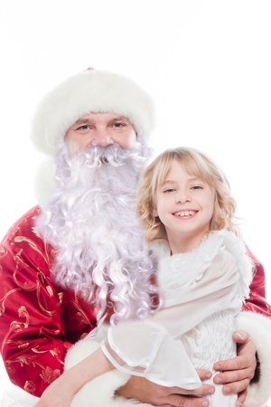 Santa Claus gives gifts to the pretty little girl Stock Photo - 16637939