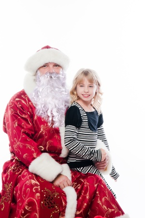 Santa Claus gives gifts to the pretty little girl photo