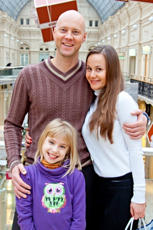 father and mother with children walking in the mall and do your Christmas shopping photo