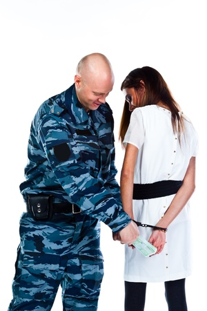 arrests: A police officer arrests a young woman