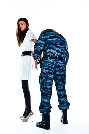A police officer arrests a young woman Stock Photo - 16799977