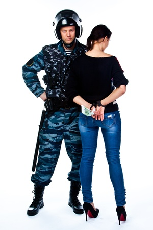 A police officer arrests a young woman Stock Photo - 16799971