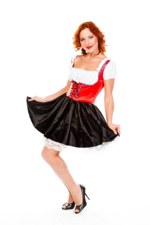 young and beautiful woman in a traditional Bavarian dress Stock Photo - 17008520