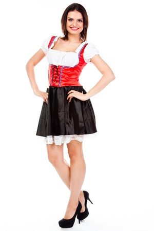 young and beautiful woman in a traditional Bavarian dress Stock Photo - 17008515