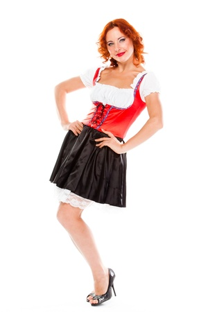 young and beautiful woman in a traditional Bavarian dress Stock Photo - 17008513