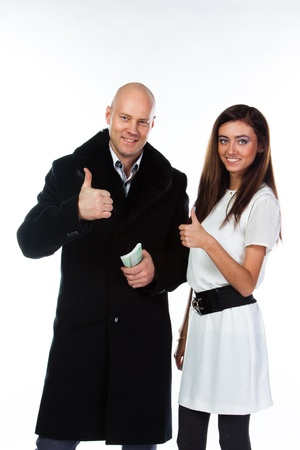 Business man with a beautiful young wife Stock Photo - 17008427