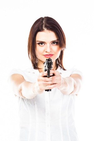 Young and beautiful woman with a gun Stock Photo - 17206369