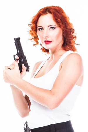 Young and beautiful woman with a gun Stock Photo - 17206332