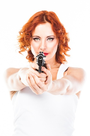 Young and beautiful woman with a gun photo