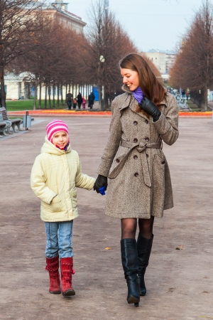 young mother walking in the park with a beautiful daughter Stock Photo - 17281183