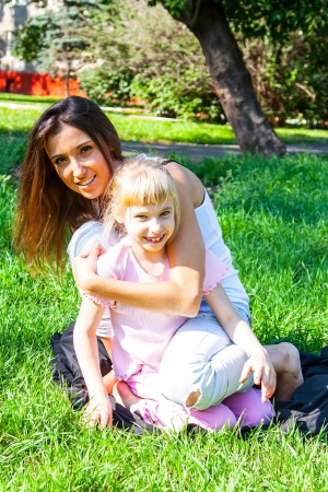 young mother walking in the park with a beautiful daughter Stock Photo - 17281231