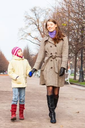 young mother walking in the park with a beautiful daughter Stock Photo - 17281196