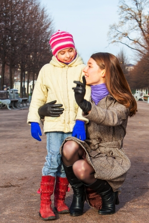 young mother walking in the park with a beautiful daughter Stock Photo - 17281226