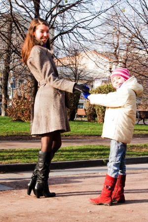 young mother walking in the park with a beautiful daughter Stock Photo - 17281301