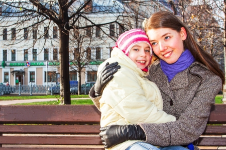young mother walking in the park with a beautiful daughter Stock Photo - 17281254