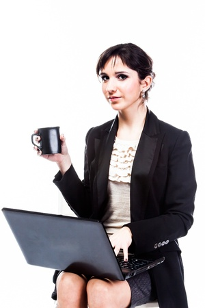 young and beautiful woman with a laptop photo