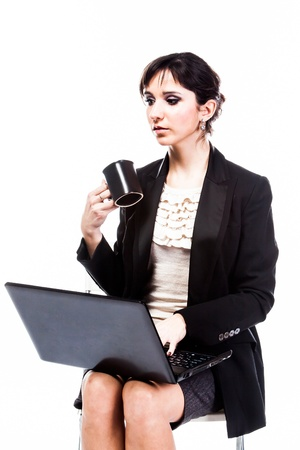 young and beautiful woman with a laptop Stock Photo - 17417597