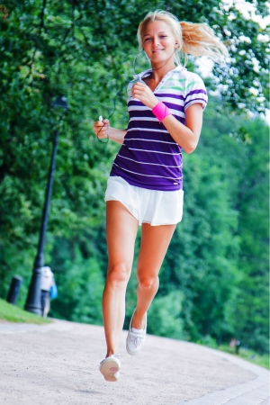 young and beautiful woman running in the park