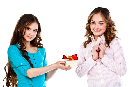 beautiful girl gives another girl a gift photo