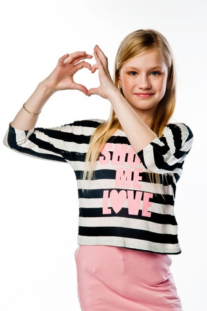 Small and beautiful girl shows fingers heart Stock Photo - 17637260