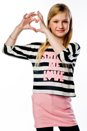 Small and beautiful girl shows fingers heart Stock Photo - 17637325