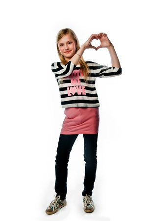 Small and beautiful girl shows fingers heart Stock Photo - 17636842