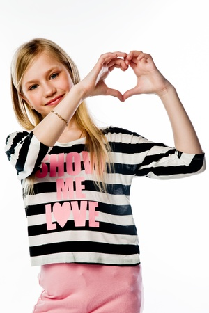 Small and beautiful girl shows fingers heart Stock Photo - 17637282