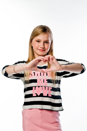 Small and beautiful girl shows fingers heart Stock Photo - 17637161