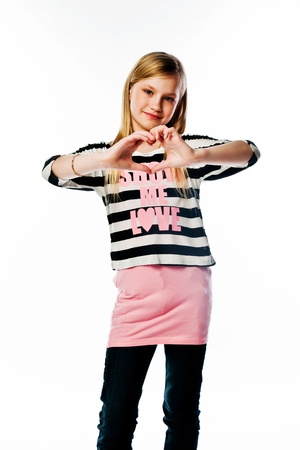 Small and beautiful girl shows fingers heart Stock Photo - 17637032