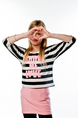 Small and beautiful girl shows fingers heart Stock Photo - 17636836