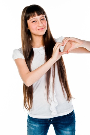 Small and beautiful girl shows fingers heart Stock Photo - 17637332