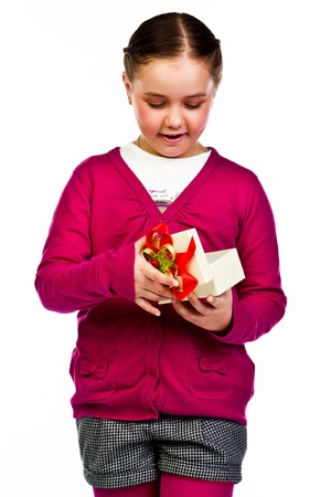 Small and beautiful girl with a gift photo