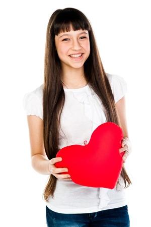 affectionate action: hermosa chica con un coraz?n de peluche Foto de archivo