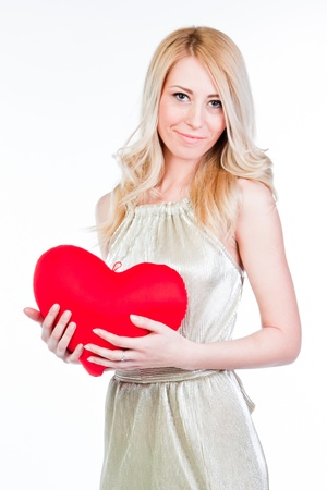 young and beautiful woman with a teddy heart photo