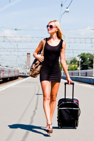 young and beautiful woman on the platform photo