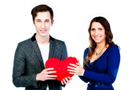 man gives a young and beautiful woman heart photo
