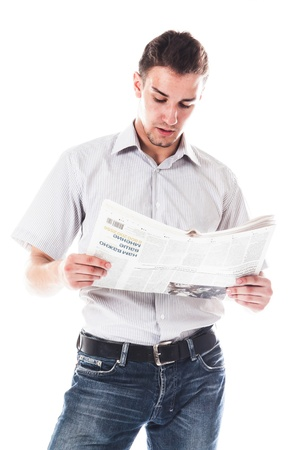 Portrait of a businessman reading a daily newspaper photo