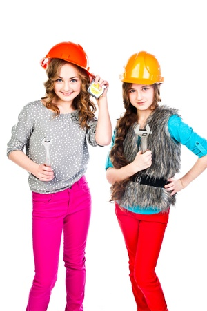 Two young beautiful girls in building helmet and tools in hand Stock Photo - 18054059