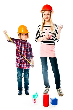 Two young beautiful girls in building helmet and tools in hand Stock Photo - 18054387