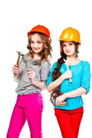 Two young beautiful girls in building helmet and tools in hand Stock Photo - 18054050