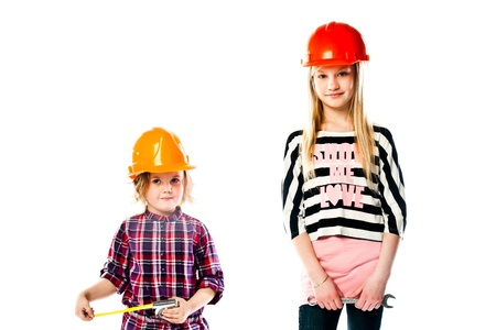 Two young beautiful girls in building helmet and tools in hand Stock Photo - 18054322
