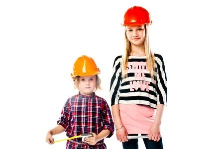 Two young beautiful girls in building helmet and tools in hand photo