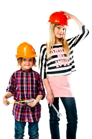 Two young beautiful girls in building helmet and tools in hand Stock Photo - 18054055