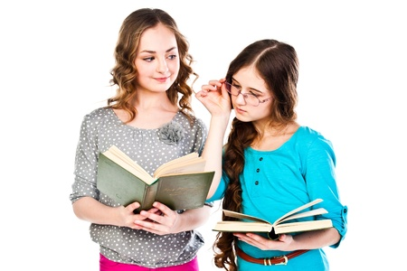 Two little beautiful girl reading a book Stock Photo - 18054069