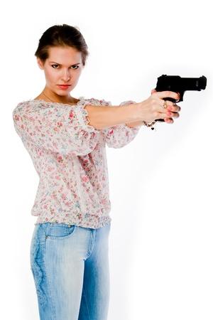 mujer con arma: Mujer joven y hermosa con una pistola Foto de archivo