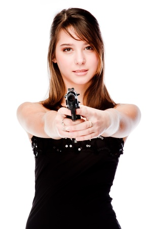 Young and beautiful woman with a gun Stock Photo